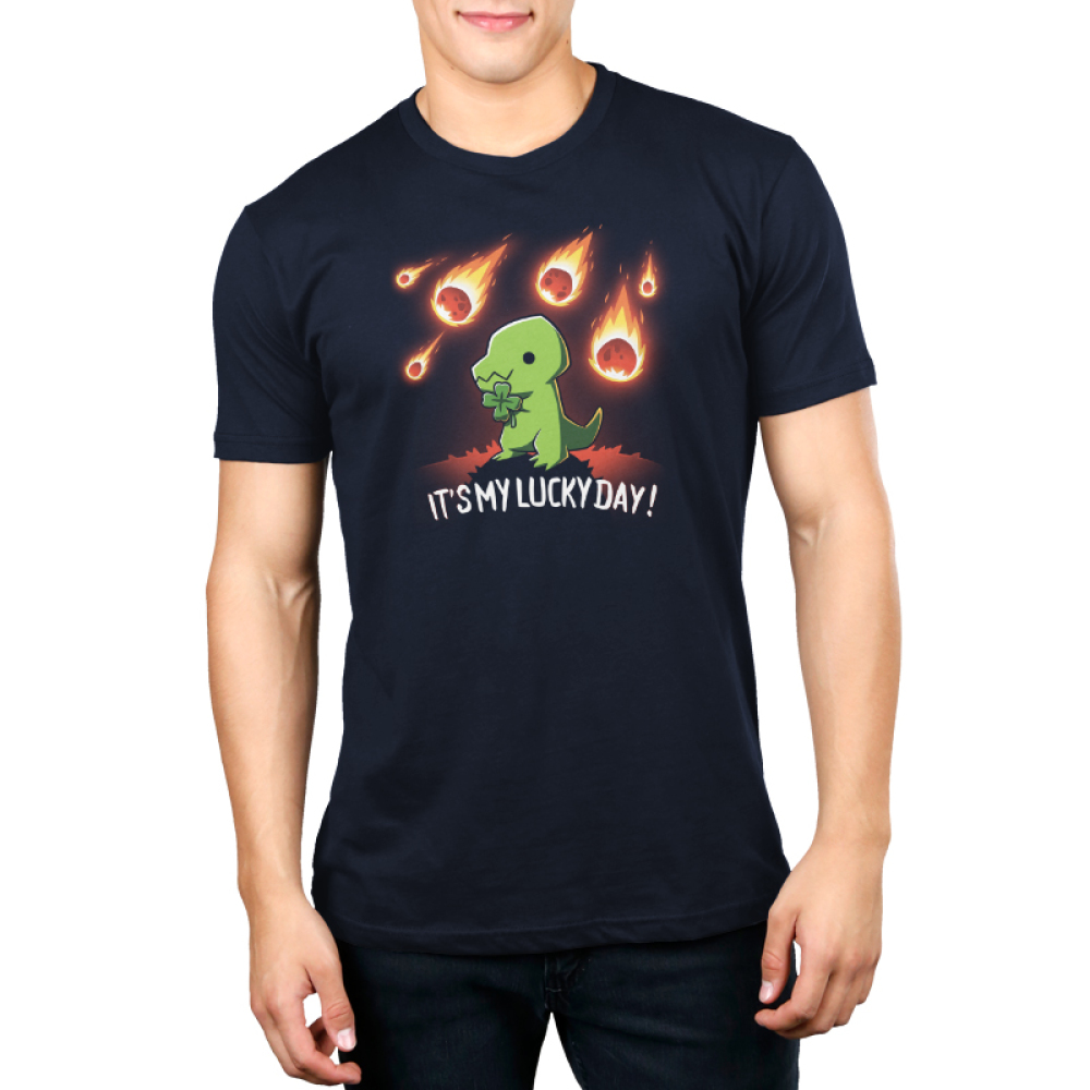 It's My Lucky Day Men's t-shirt model TeeTurtle navy t-shirt featuring a smiling green tyrannosaurus rex holding a four-leaf clover with a meteor shower in the background.