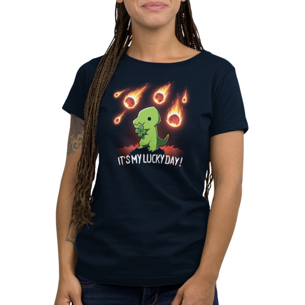 It's My Lucky Day Women's t-shirt model TeeTurtle navy t-shirt featuring a smiling green tyrannosaurus rex holding a four-leaf clover with a meteor shower in the background.