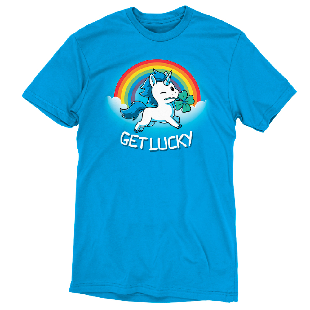 Get Lucky (Unicorn) t-shirt TeeTurtle cobalt blue t-shirt featuring a white unicorn with blue fur holding a clover in its mouth with clouds and a rainbow behind him