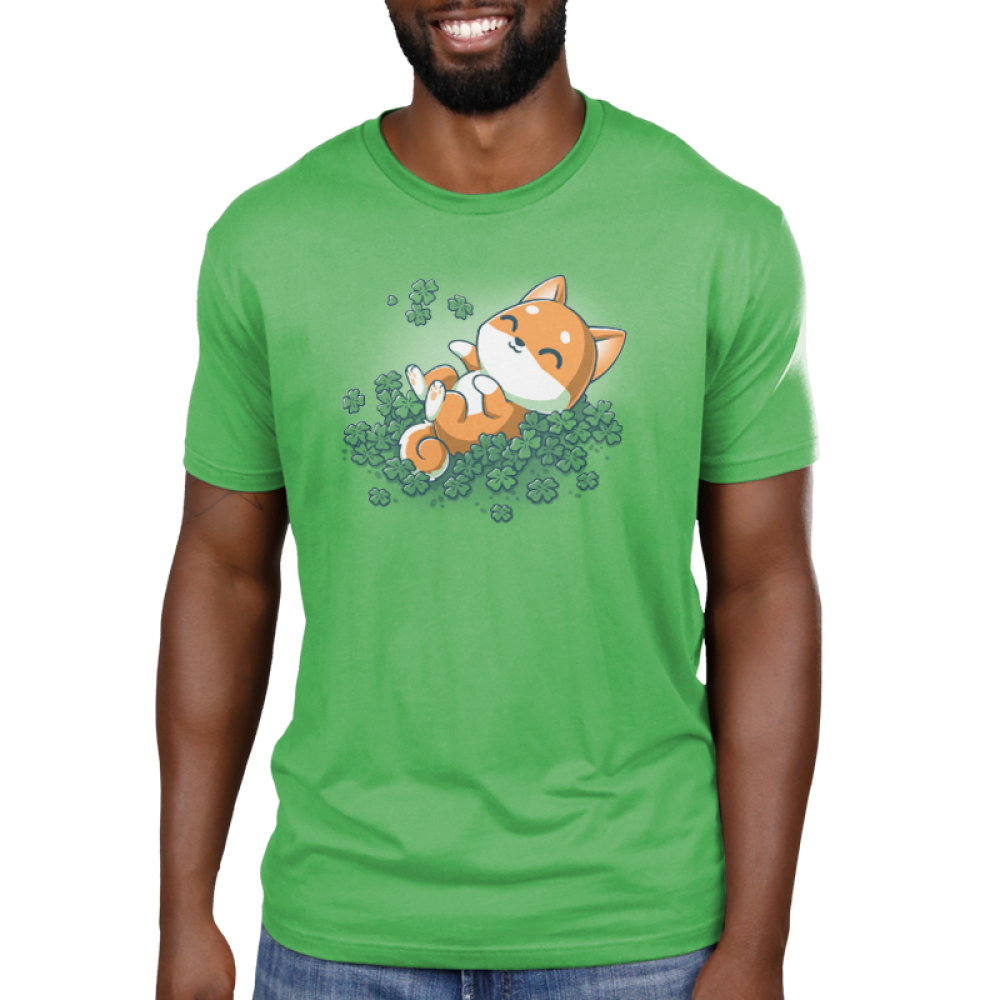 Lucky Shiba Men's t-shirt model teeturtle original black t-shirt featuring a happy orange Shiba Inu dog rolling around in green shamrock clovers