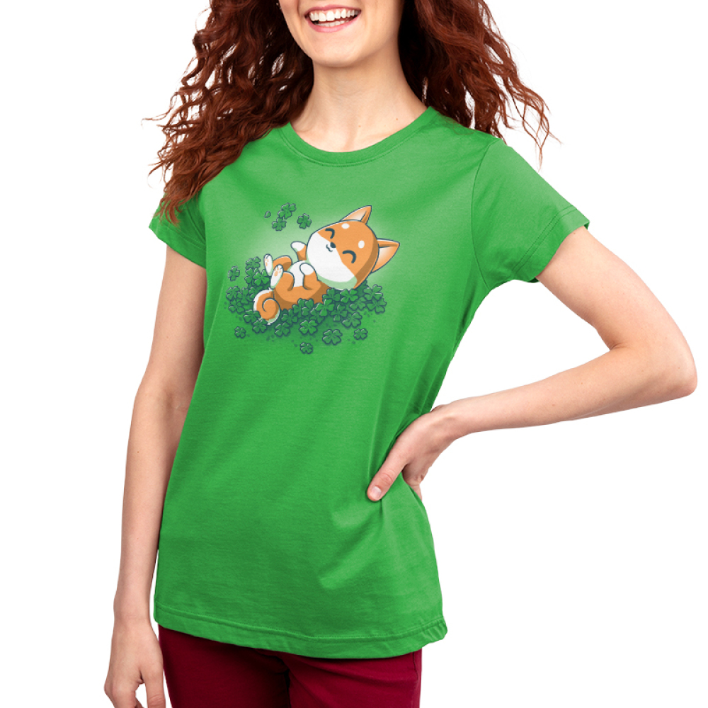 Lucky Shiba Women's t-shirt model teeturtle original black t-shirt featuring a happy orange Shiba Inu dog rolling around in green shamrock clovers