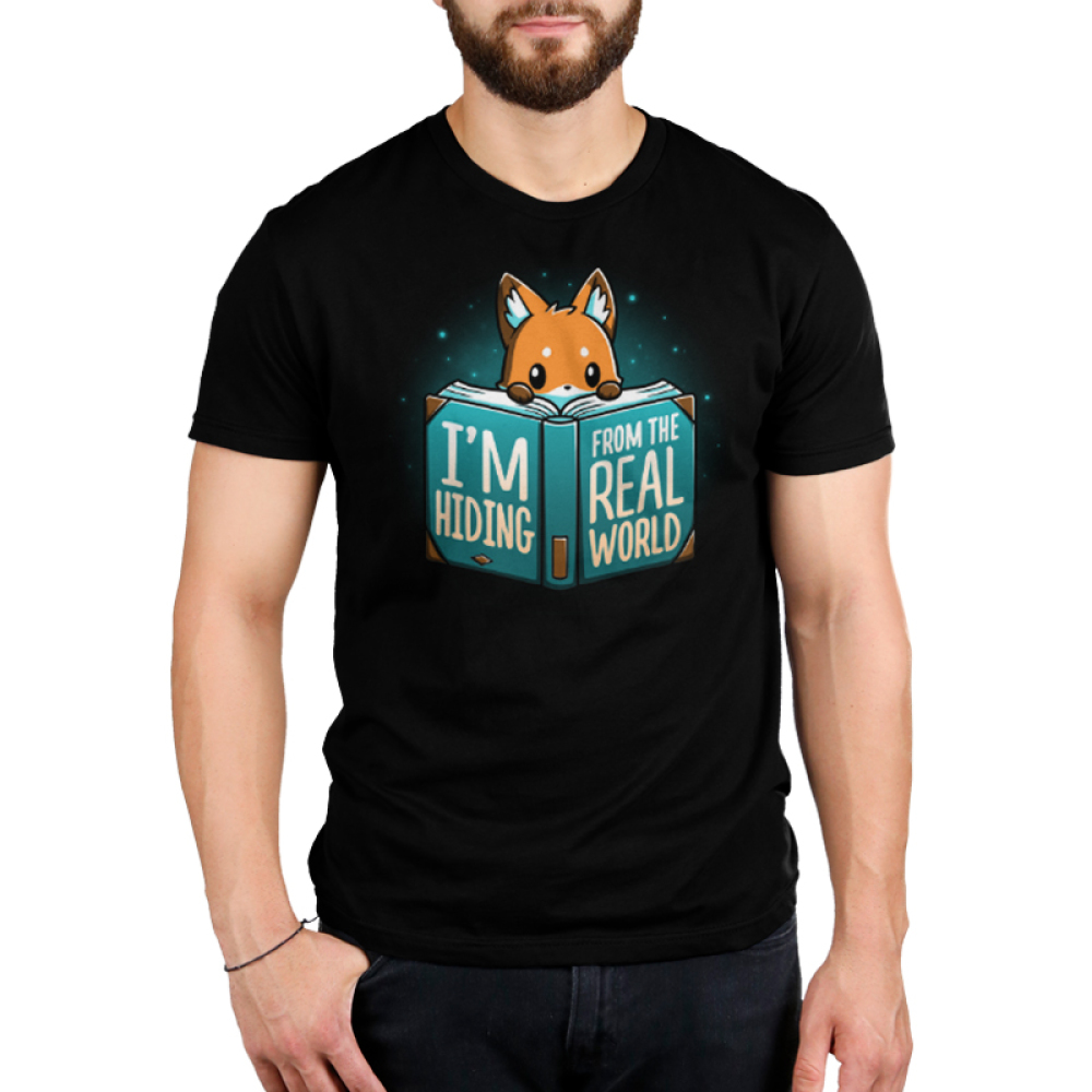 I'm Hiding From the Real World Men's t-shirt model TeeTurtle black t-shirt featuring a fox crouching behind a big blue book with his paws and head peaking over the pages