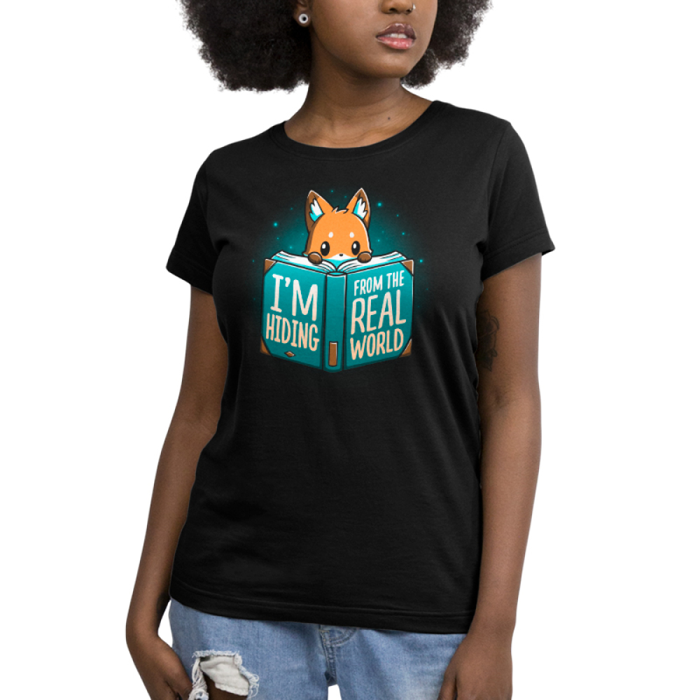 I'm Hiding From the Real World Women's t-shirt model TeeTurtle black t-shirt featuring a fox crouching behind a big blue book with his paws and head peaking over the pages