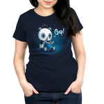 Plot Twist Women's t-shirt model TeeTurtle navy t-shirt featuring a panda sitting on the ground holding open a blue book with a surprised look on its face and its paw up to its mouth with little twinkling lights behind him