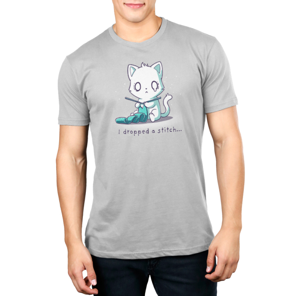 I Dropped a Stitch Men's t-shirt model TeeTurtle silver t-shirt featuring an anxious white cat knitting a green scarf with tiny white sparkles in the background.