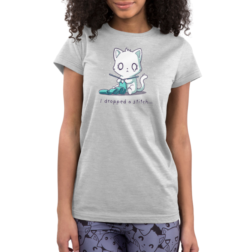 I Dropped a Stitch Junior's t-shirt model TeeTurtle silver t-shirt featuring an anxious white cat knitting a green scarf with tiny white sparkles in the background.