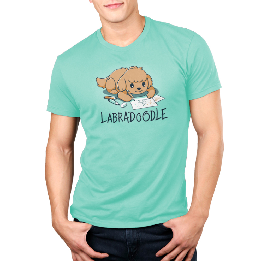 Labradoodle Men's t-shirt model TeeTurtle chill blue t-shirt featuring a brown lab dog on the floor coloring pictures of boats with pencils and markers around him
