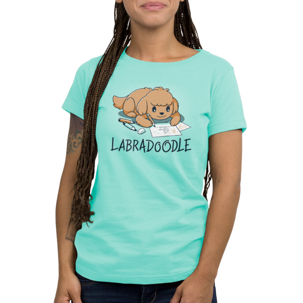 Labradoodle Women's t-shirt model TeeTurtle chill blue t-shirt featuring a brown lab dog on the floor coloring pictures of boats with pencils and markers around him