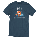 Shhh! I'm Counting Stitches!denim blue t-shirt featuring a red panda shushing someone while knitting a blue and light blue scarf while surrounded by large blue and light blue balls of yarn.