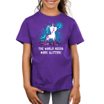 The World Needs More Glitter Kid's t-shirt model TeeTurtle purple t-shirt featuring a white unicorn with blue fur with pink glitter all over her holding a paint brush in her mouth and crafting supplies scattered by her feet