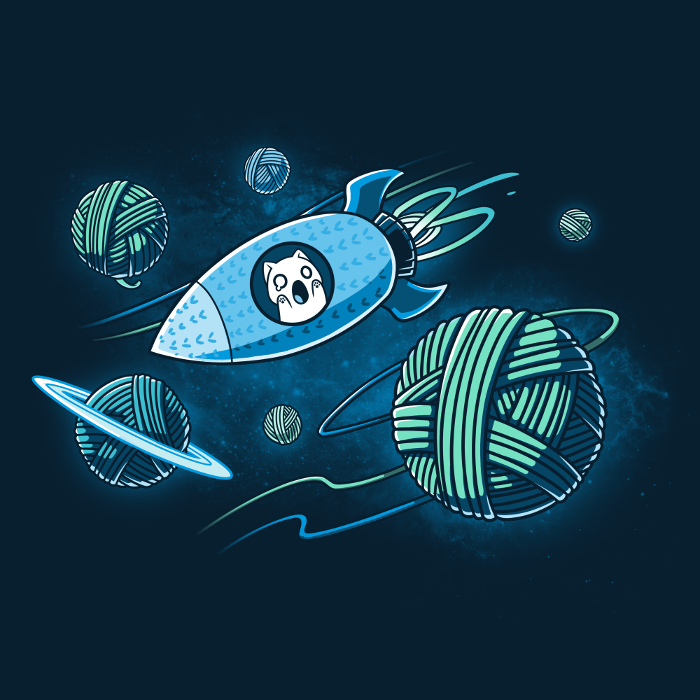 Galactic Crafts t-shirt TeeTurtle navy t-shirt featuring a white cat in a spaceship with its mouth wide open and paws on the window flying around big planets that are in the shape of yarn balls