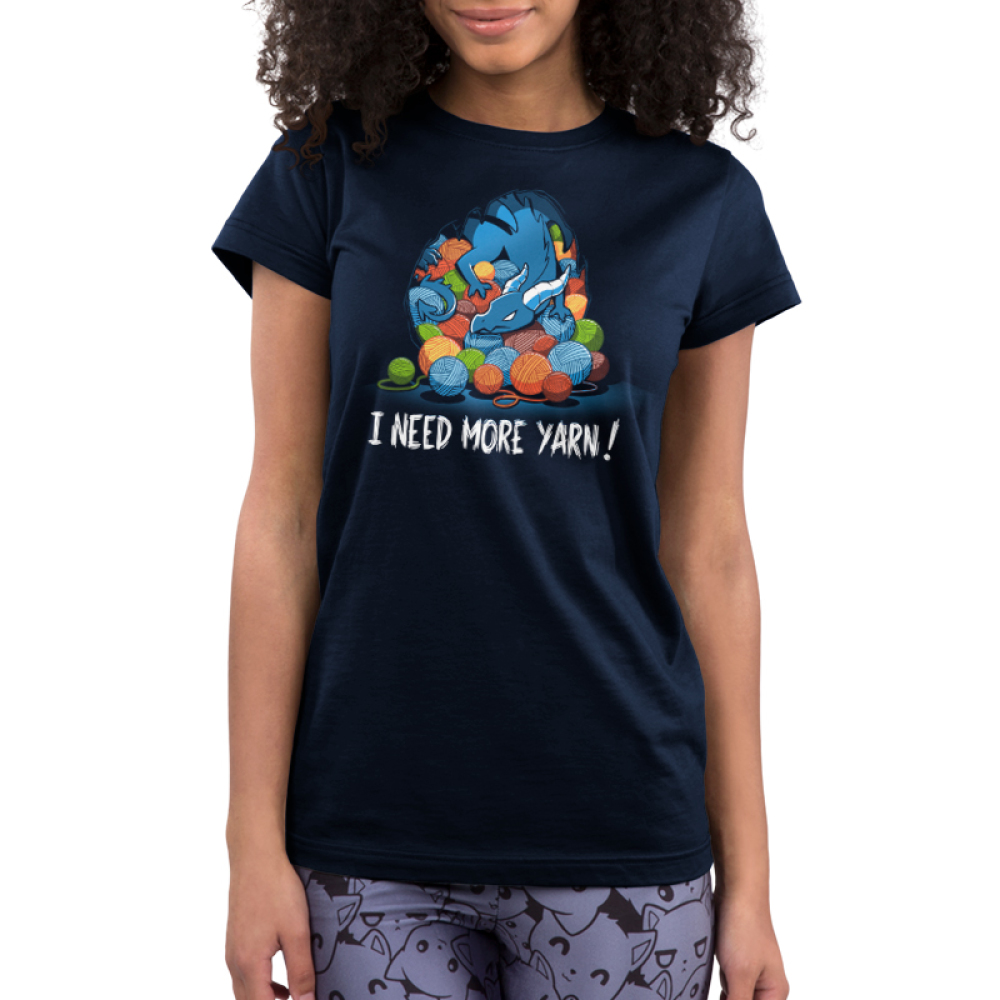 Yarn Hoarder Junior's t-shirt model TeeTurtle navy t-shirt featuring a blue dragon on top of a huge pile of multi colored yarn balls