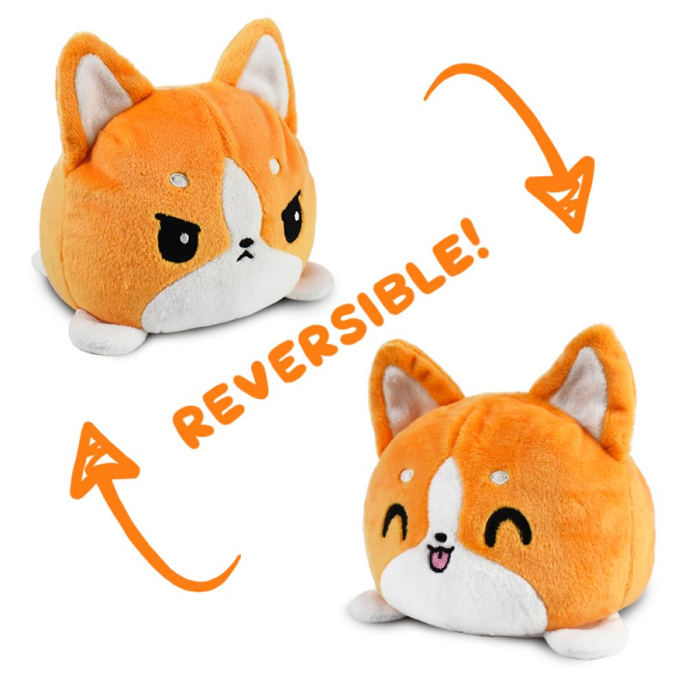 Reversible Corgi Plushie featuring an angry orange and white corgi that flips into a happy orange and white corgi.