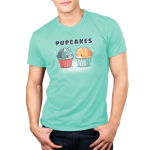 Pupcakes Men's t-shirt model TeeTurtle chill blue t-shirt featuring a husky puppy in the shape of a cupcake with white sprinkles with a red wrapper on the left-hand side, and a corgi puppy in the shape of a cupcake with white sprinkles and a chill blue wrapper on the right-hand side with a sparkly background.