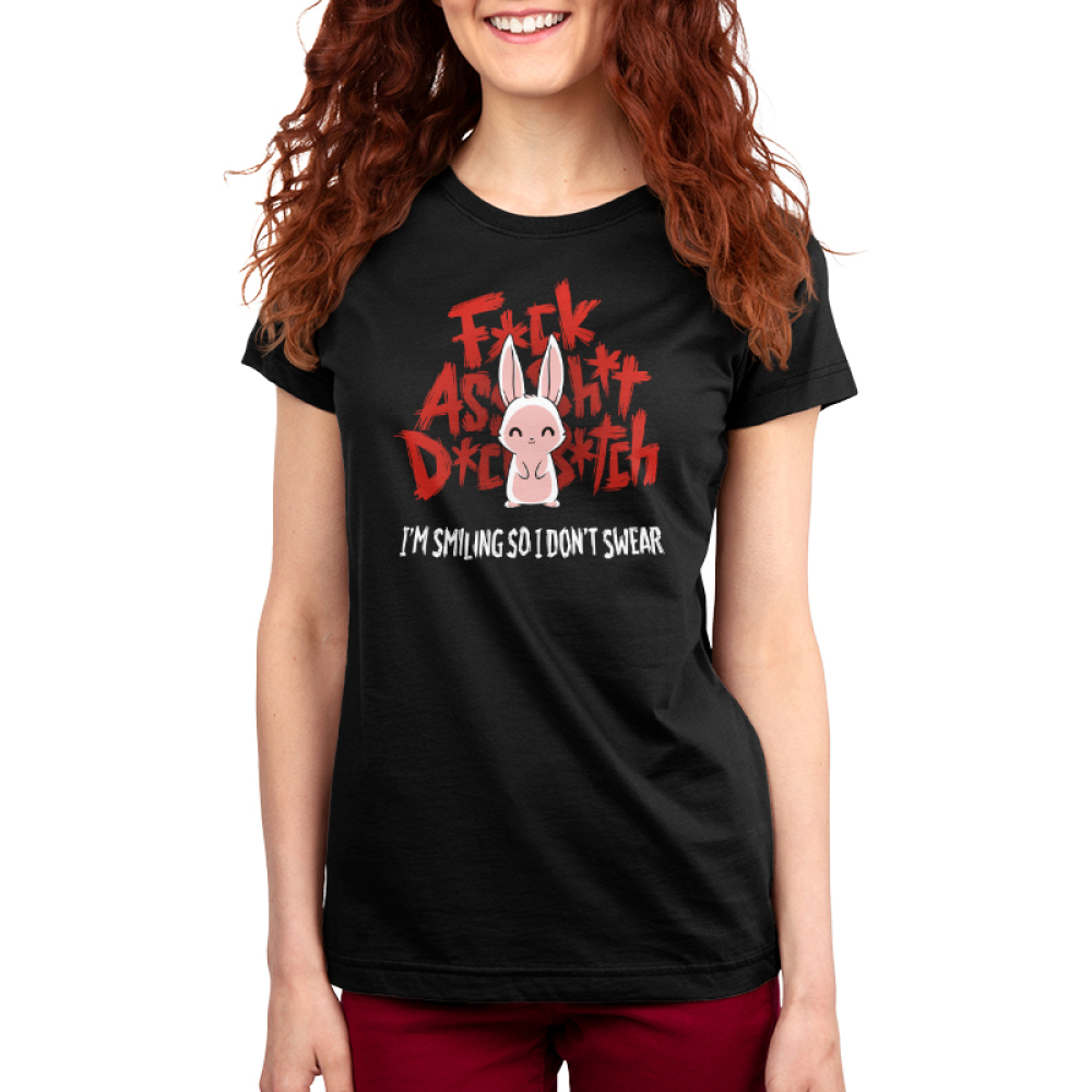 I'm Smiling so I Don't Swear Women's t-shirt model TeeTurtle black t-shirt featuring a white bunny giving a smile with big red curse words behind him