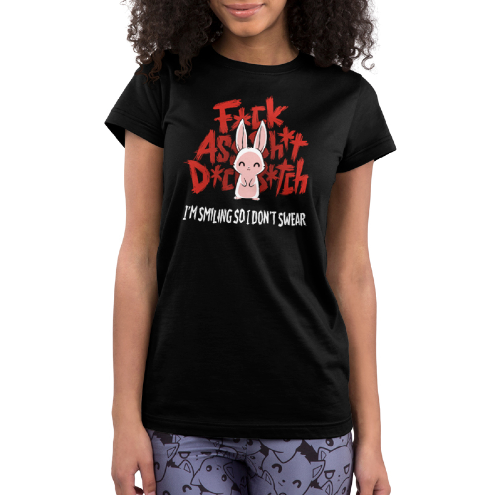 I'm Smiling so I Don't Swear Junior's t-shirt model TeeTurtle black t-shirt featuring a white bunny giving a smile with big red curse words behind him