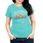 Let's Get Baked Women's t-shirt model TeeTurtle Caribbean blue t-shirt featuring four little cookie dough figures running with big smiles on their faces