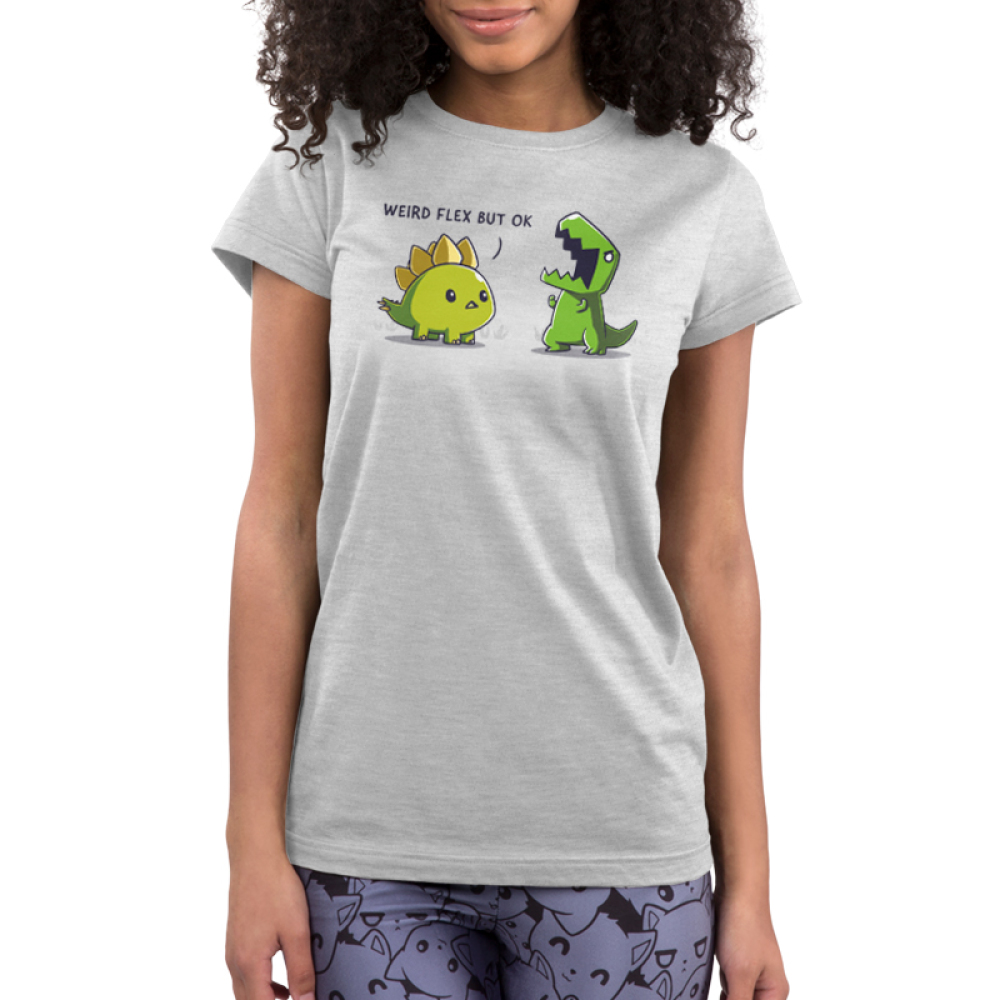 Weird Flex but Okay Junior's t-shirt model TeeTurtle silver t-shirt featuring a stegosaurus staring at a t-rex flexing its arms and yelling