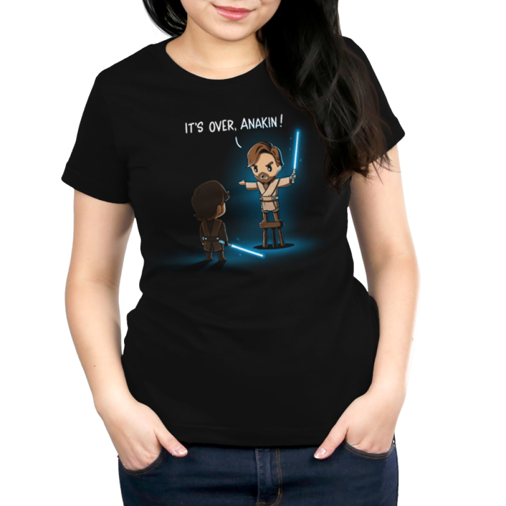 It's Over, Anakin Women's t-shirt model officially licensed black t-shirt featuring Obi-Wan on a stool talking down to Anakin with lightsabers drawn