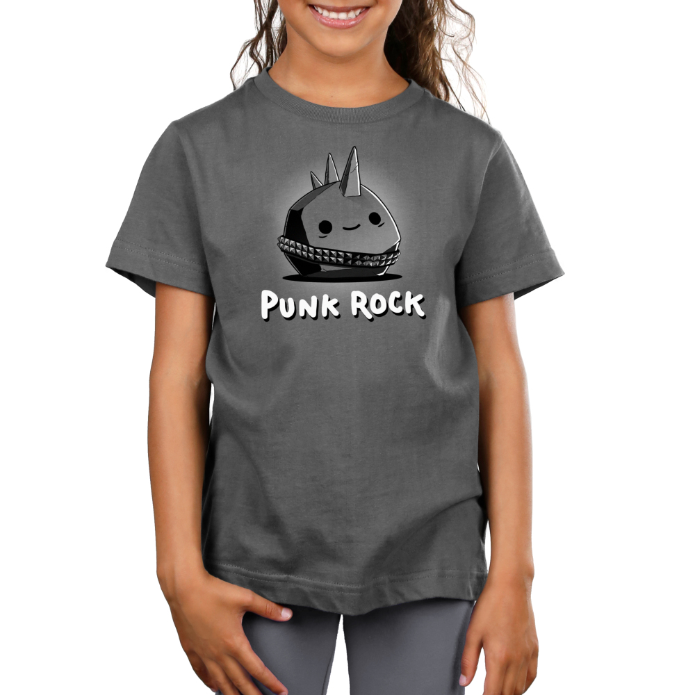 Punk Rock Kid's t-shirt model TeeTurtle charcoal t-shirt featuring a gray smiling rock with a spiky belt on and a mohawk