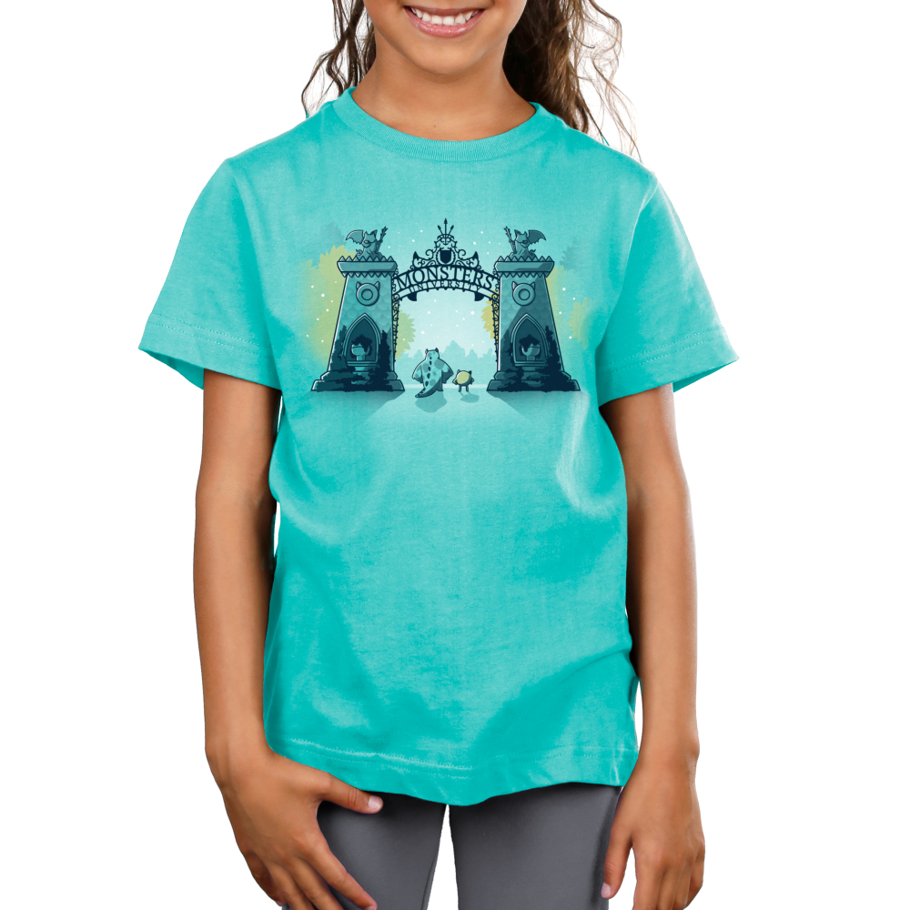 Monsters University Kid's tshirt model officially licensed caribbean blue tshirt featuring Sulley and Mike standing in front of the gates of monsters university