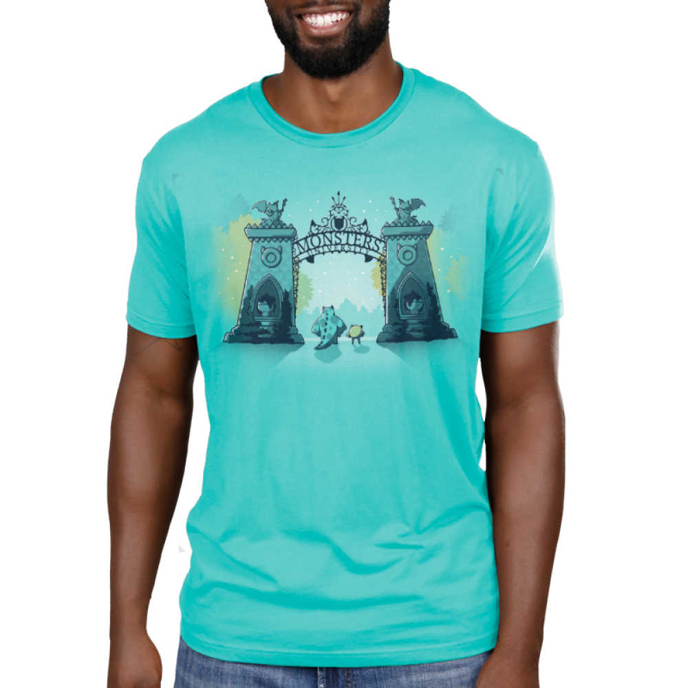 Monsters University Men's tshirt model officially licensed caribbean blue tshirt featuring Sulley and Mike standing in front of the gates of monsters university