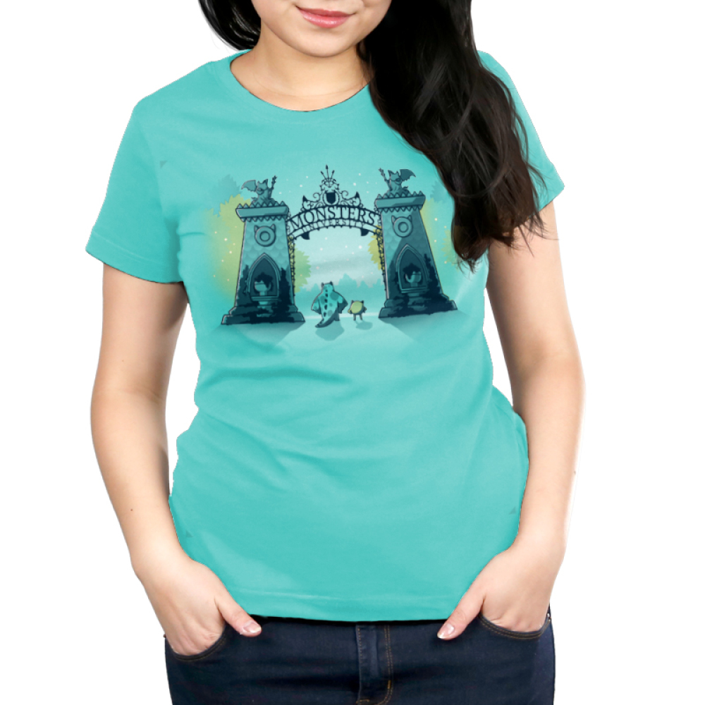 Monsters University Women's tshirt model officially licensed caribbean blue tshirt featuring Sulley and Mike standing in front of the gates of monsters university