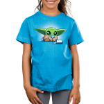 Nevarro Nummies kids tshirt model officially licensed cobalt shirt featuring Grogu eating some snacks he stole from a child