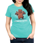 Strong as a Mother Women's t-shirt model TeeTurtle caribbean blue t-shirt featuring a mama brown bear with her arms up flexing with four baby cubs handing on her