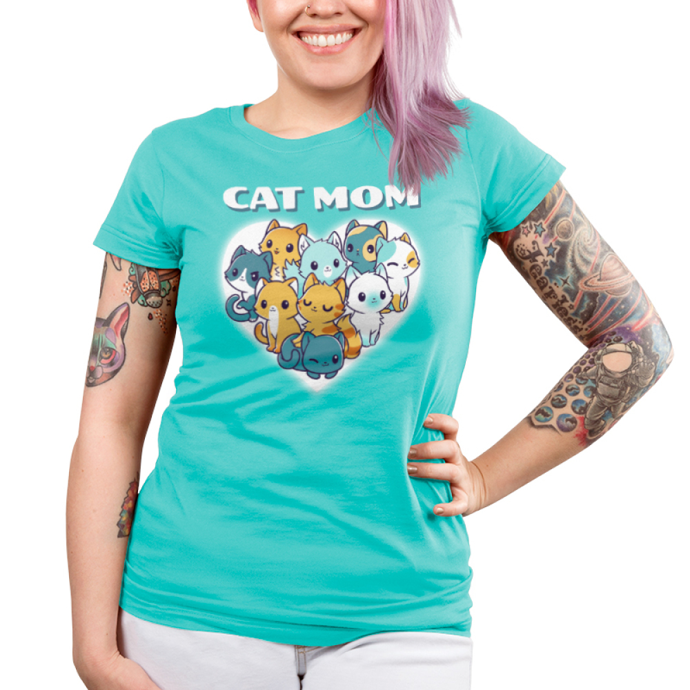 I'm a Cat Mom Juniors t-shirt model TeeTurtle cobalt blue t-shirt featuring a white heart with 9 different cats in the middle