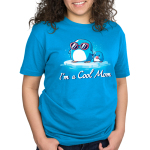I'm a Cool Mom Standard t-shirt model TeeTurtle cobalt blue t-shirt featuring a mama penguin in pink sunglasses on a floating ice burg holding the hand of a baby penguin holding a lolly pop