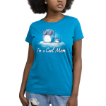 I'm a Cool Mom Women's t-shirt model TeeTurtle cobalt blue t-shirt featuring a mama penguin in pink sunglasses on a floating ice burg holding the hand of a baby penguin holding a lolly pop