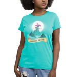 Adventure Beckons Women's t-shirt model TeeTurtle Caribbean blue t-shirt featuring blue mountains in the middle of wavy water with a big purple dragon sitting on the highest peak with a big sun behind him and birds flying