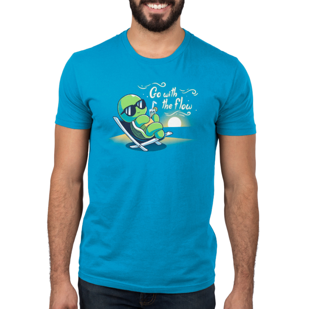 Go With the Flow Men's t-shirt model TeeTurtle cobalt blue t-shirt featuring a turtle in an outdoor lounge chair with sunglasses on sipping a lemonade with a sun setting behind him