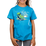 Go With the Flow Kid's t-shirt model TeeTurtle cobalt blue t-shirt featuring a turtle in an outdoor lounge chair with sunglasses on sipping a lemonade with a sun setting behind him