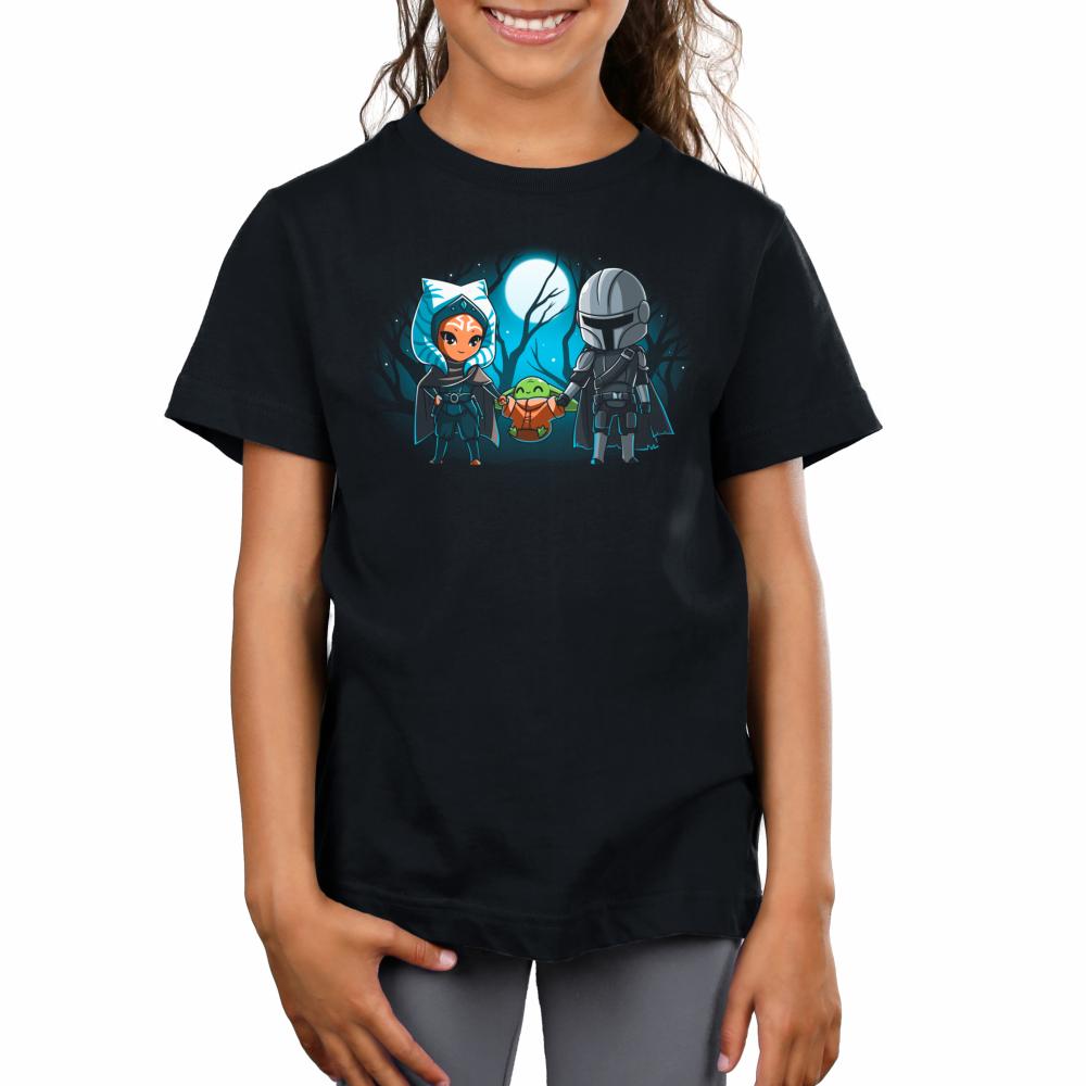 Grogu's family kids tshirt model officially licensed black tshirt featuring ahsoka grogu and mando all holding hands under the moon