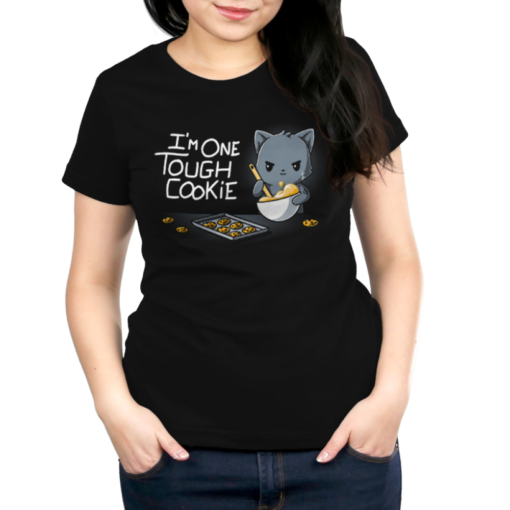 I'm One Tough Cookie Women's t-shirt model TeeTurtle black t-shirt featuring a gray cat mixing a whole of cookie dough looking tough with a baking sheet and cookies in front of him