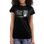 I'm One Tough Cookie Junior's t-shirt model TeeTurtle black t-shirt featuring a gray cat mixing a whole of cookie dough looking tough with a baking sheet and cookies in front of him