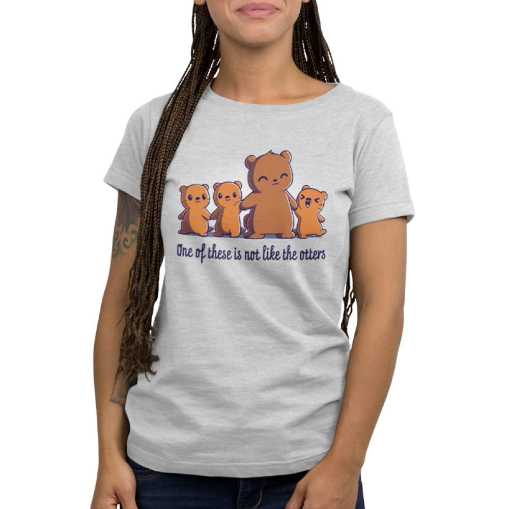 One of These is Not Like the Otters Women's t-shirt model TeeTurtle silver t-shirt featuring a mama otter holding hands with her three little otters, two on her left, and one smiling big on her right