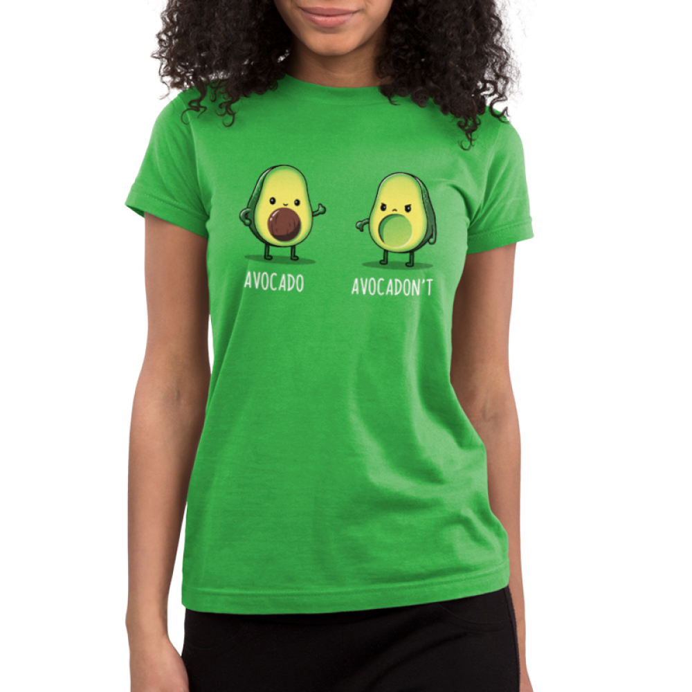 Avocadon't Junior's t-shirt model TeeTurtle apple green t-shirt featuring one avocado smiling giving a thumbs up and another looking upset with a thumbs down