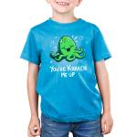 You're Kraken Me Up Kid's t-shirt model TeeTurtle cobalt blue t-shirt featuring a green Kraken under water laughing with bubbles around him