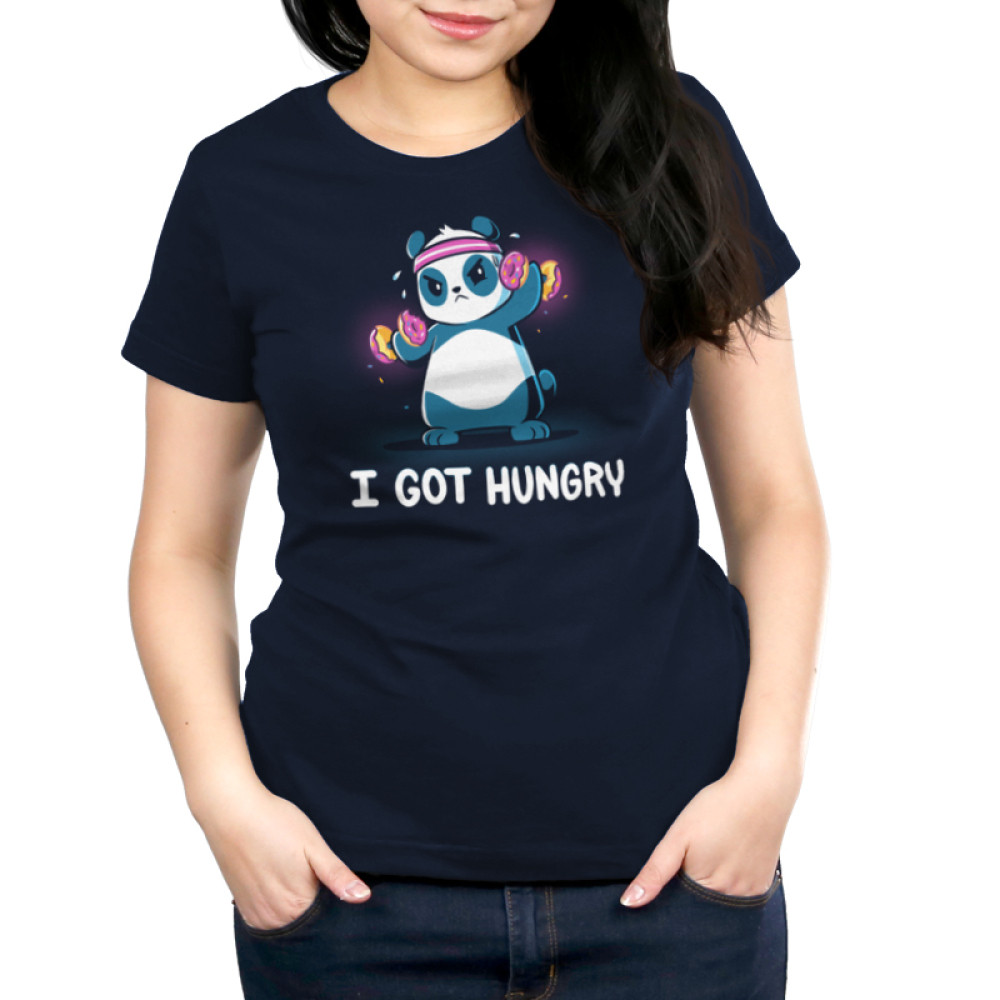 I Got Hungry Women's t-shirt model TeeTurtle navy t-shirt featuring a sweaty panda wearing a pink sweat band on its head lifting hand weights with donuts on them