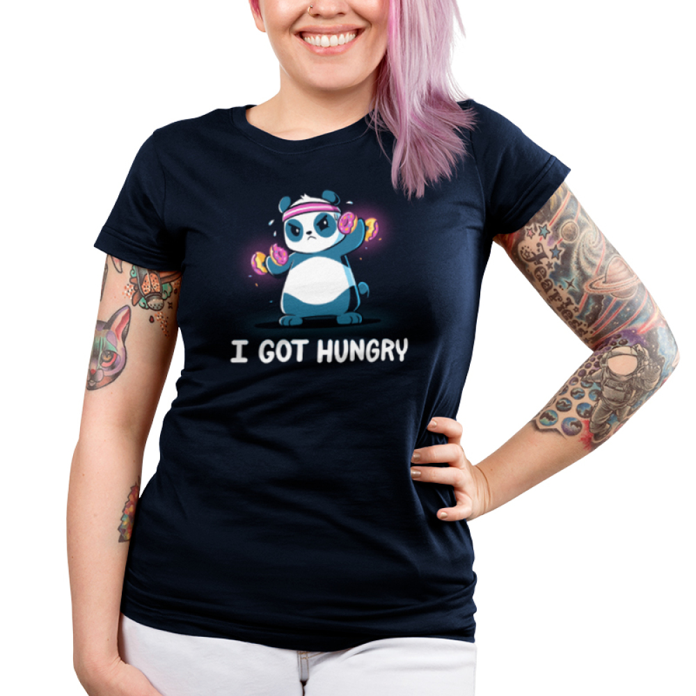I Got Hungry Junior's t-shirt model TeeTurtle navy t-shirt featuring a sweaty panda wearing a pink sweat band on its head lifting hand weights with donuts on them