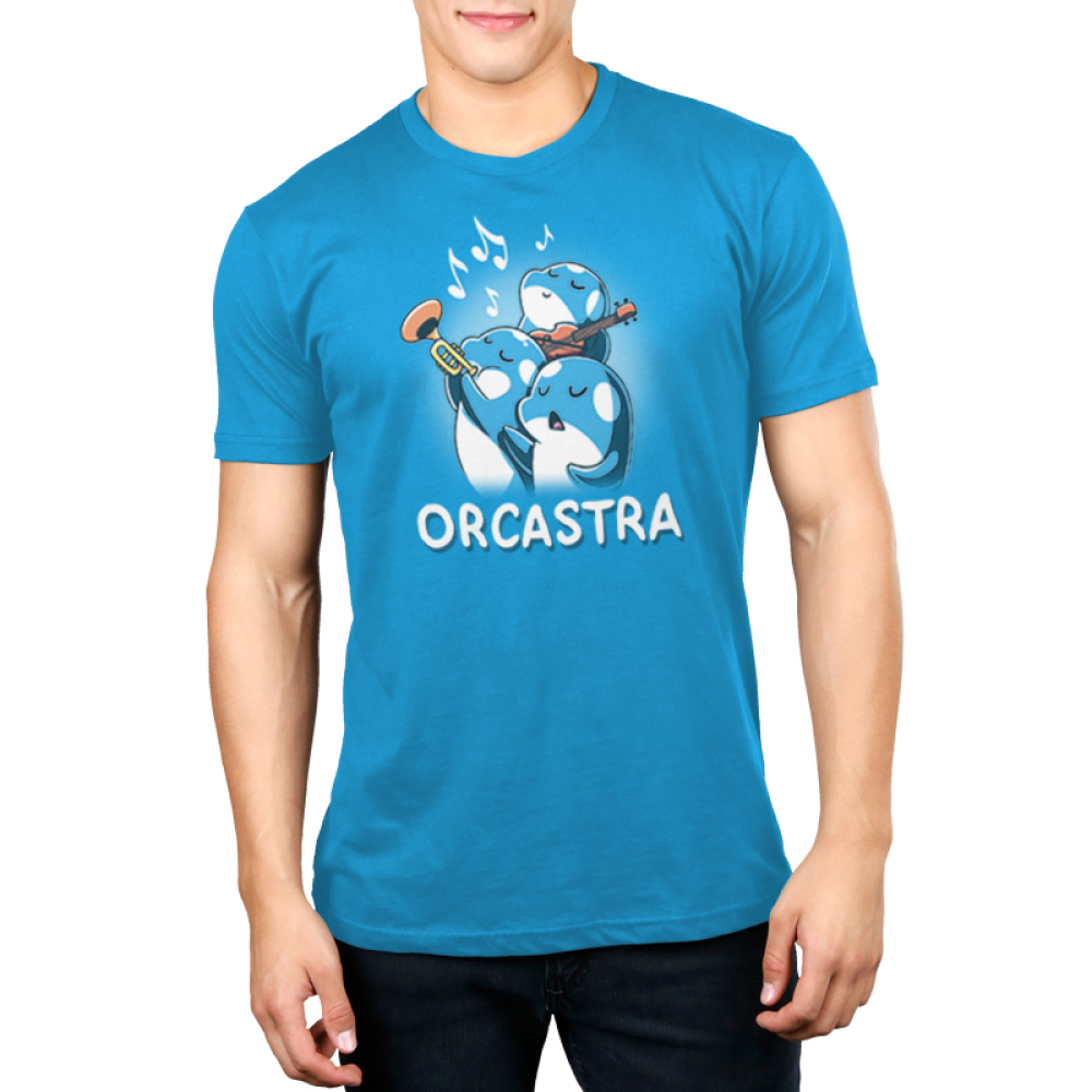 Orcastra Men's t-shirt model TeeTurtle cobalt blue t-shirt featuring 3 orca whales, one singing, one playing the trumpet, one playing the violin with music notes around them