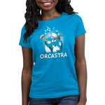 Orcastra Women's t-shirt model TeeTurtle cobalt blue t-shirt featuring 3 orca whales, one singing, one playing the trumpet, one playing the violin with music notes around them