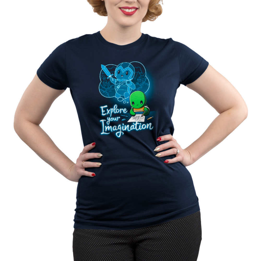 Explore Your Imagination Junior's t-shirt model TeeTurtle navy t-shirt featuring a green turtle drawing a turtle in battle armor holding a sword with an imagination bubble showing his drawing