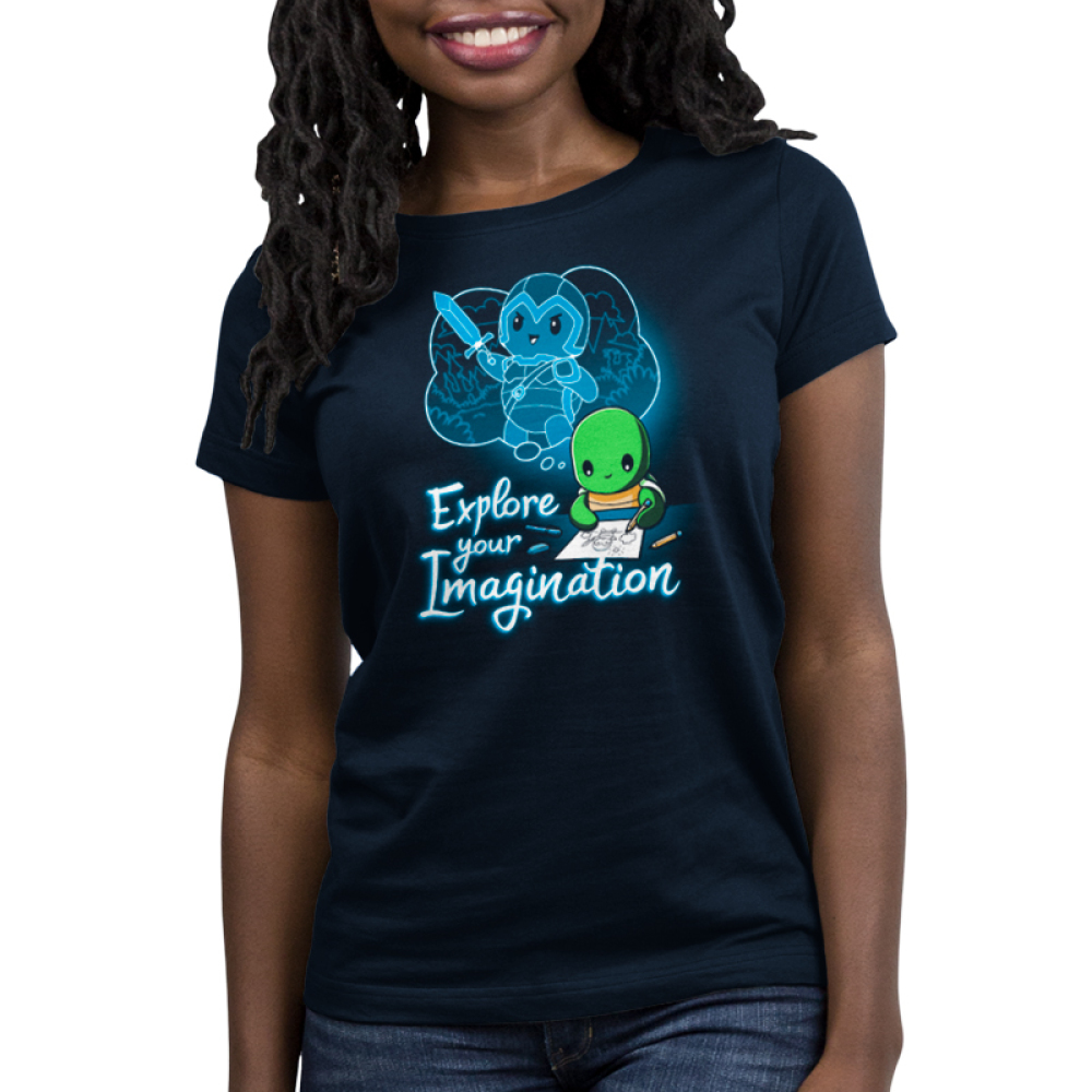 Explore Your Imagination Women's t-shirt model TeeTurtle navy t-shirt featuring a green turtle drawing a turtle in battle armor holding a sword with an imagination bubble showing his drawing
