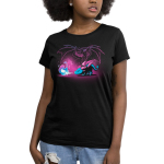 Spirit of the Dragon Women's t-shirt model TeeTurtle black t-shirt featuring a little blue and purple dragon bending down breathing blue and purple fire with a big grown dinosaur outlined behind him