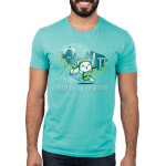 Gotta Explore Everything Men's t-shirt model TeeTurtle caribbean blue t-shirt featuring a white cat in a green floppy cap and green vest holding a sword and a scroll running with mountains, trees, and birds behind him