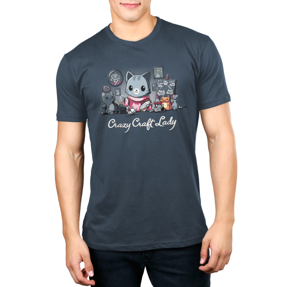 Crazy Craft Lady Men's t-shirt model TeeTurtle denim blue t-shirt featuring a gray stripped cat in a pink cat sweaters with tons of cat crafts all around them - paintings, pictures, stuffed animals, etc.